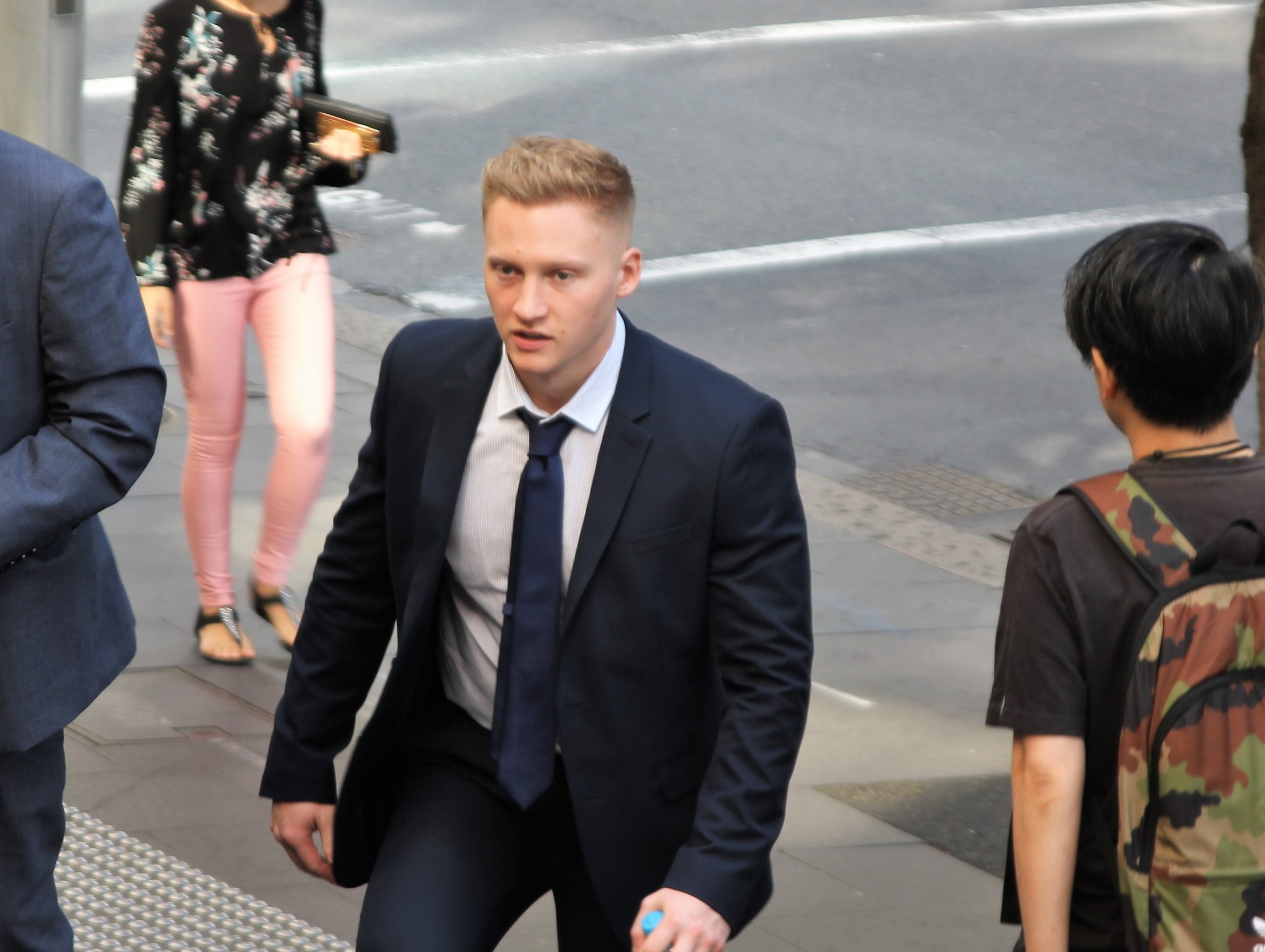 Sam Oliver arriving at Downing Centre court in Sydney, Australia. British man Sam Oliver is standing trial at the court, accused of a one-punch attack on former captain of Australia's Rugby Sevens James Stannard. PRESS ASSOCIATION Photo. Picture date: Wednesday September 12. See PA story COURTS Australia. Photo credit should read: Alex Britton/PA Wire