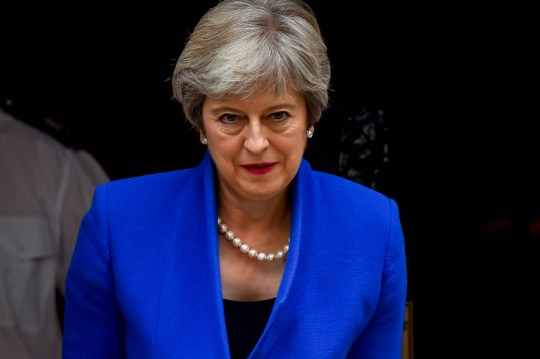 """SIPA USA via PA Images British Prime Minister Theresa May leaves 10 Downing Street as she heads to Birmingham to speak at the world's first """"zero emission vehicle summit"""", London on September 11, 2018. (Photo by Alberto Pezzali/NurPhoto/Sipa USA)"""