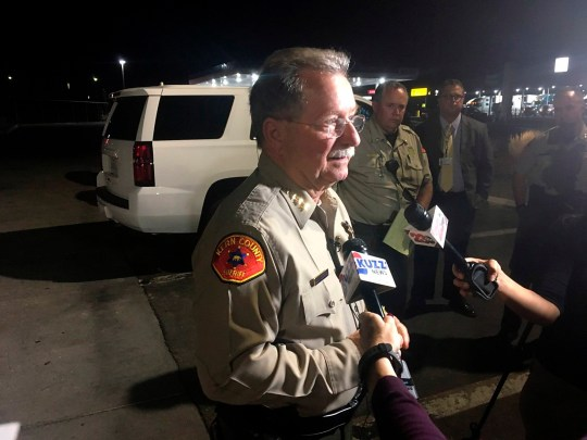 Kern County Sheriff Donny Youngblood talks to the media, Wednesday, Sept. 12, 2018, in southeast Bakersfield, Calif., where authorities say a gunman killed multiple people. (Sam Morgen/The Bakersfield Californian via AP)