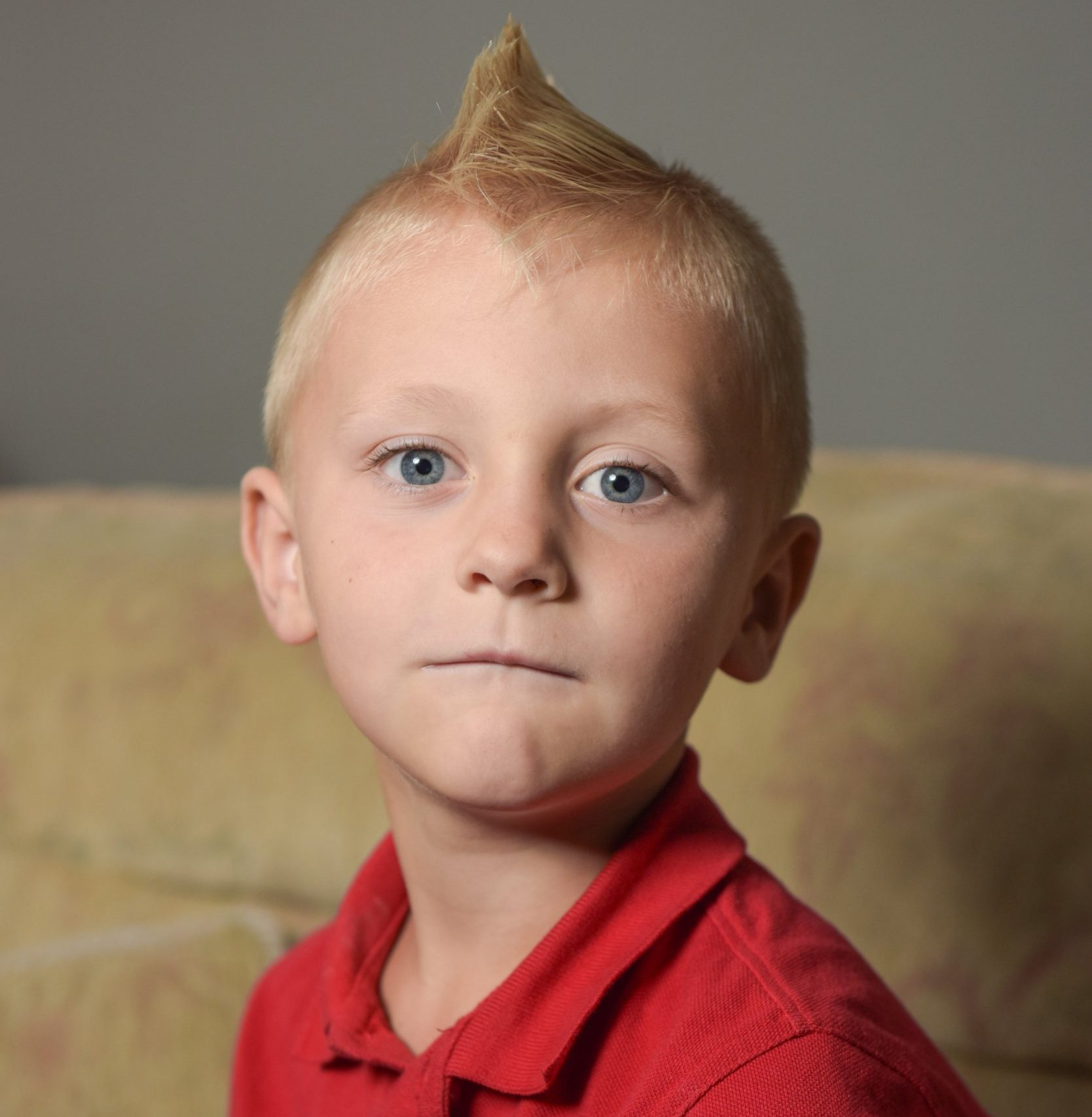 Pic by Michael Scott/Caters News - (PICTURED: Charlie Chafer, 6 from Milton Keynes has been told that he is unable to go to school due to his mohawk hair style that might poke someones eye out. Pic taken 12/09/2018) - A furious mum claims her son was banned from school over his 4cm long mohawk because it could poke another child in the eye. Little Charlie Chafer, six, chose the punk hairstyle himself a month ago before starting back at Drayton Park Primary School in Bletchley, Milton Keynes, last week after the summer holidays. But mum Kirstie Lea Day, 26, claims she was called by the school on Friday [September 7] and told her sons hairstyle was not acceptable and he would not be allowed in class until he changed it. Stay-at-home mum Kirstie, who is also mum to Demi-Lee, eight, and four-year-old Emily, alleges when she brought Charlie back to school this week, the headmaster told her she should shave her sons head or take him home. And she said another teachers eventual solution to allowing Charlie back into class was to pour water onto his hair to flatten it down. SEE CATERS COPY.