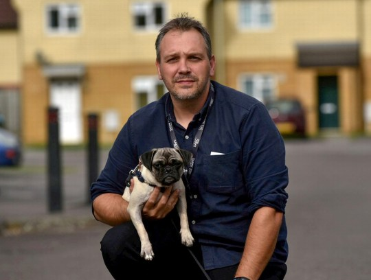 Dean Brazil and dog Nala. See SWNS story SWPUG; A Cheltenham family has hit out at an insurance firm in a row over a hermaphrodite pug. Dean Brazil, of Princess Elizabeth Way, is angry after Direct Line refused to pay for a ??1,500 operation to remove the penis of eight-month-old crossbreed dog Nala. Mr Brazil, a 38-year-old dad-of-seven, only found out the pug had both male and female genitalia after he bought her. Vets have told the Brazil family this could put Nala???s health at risk, which Mr Brazil says has caused them ???great upset and concern???.