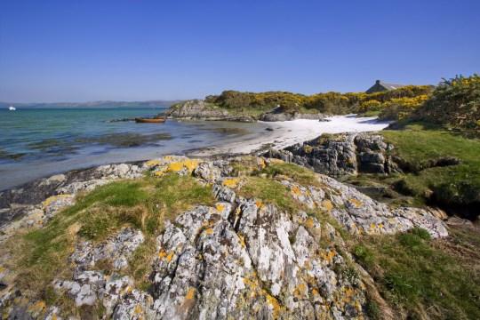 Beautiful sandy bay on the island of Gigha, Argyll, Scotland, United Kingdom. (Photo by: UIG via Getty Images)