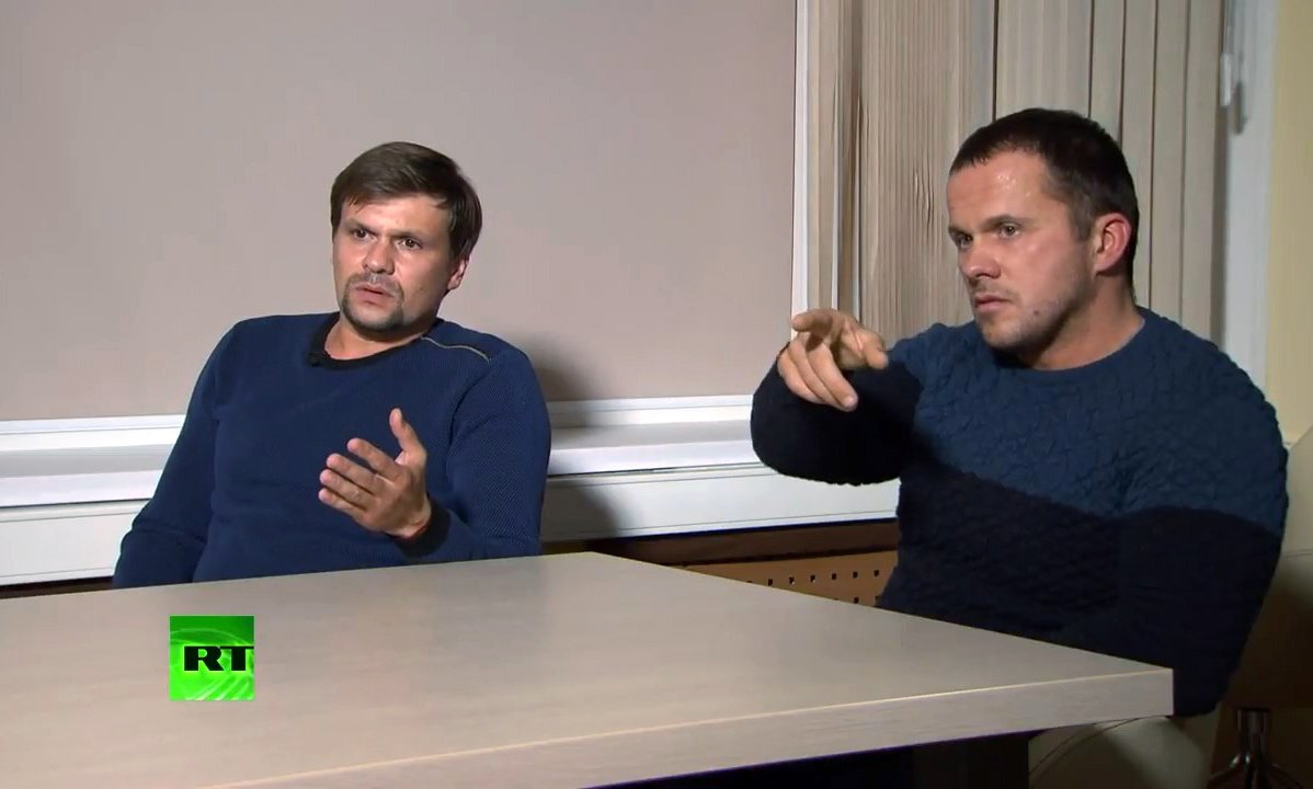 MOSCOW, RUSSIA - SEPTEMBER 13, 2018: Ruslan Boshirov (L) and Alexander Petrov, suspected by the British authorities of poisoning former GRU officer Sergei Skripal and his daughter Yulia in Salisbury, United Kingdom in March 2018, give an interview to the RT news channel. RT video screengrab/TASS (Photo by TASS\TASS via Getty Images)