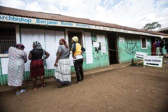 KIBERA SLUM, NAIROBI, NAIROBI COUNTY, KENYA - 2017/08/08: Four women are checking names on the vote polling station at a christian church in Kibera Slum, Nairobi. (Photo by J?n Hus?r/SOPA Images/LightRocket via Getty Images)