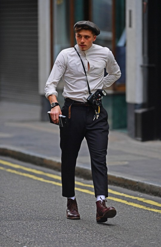 5e84f889e Brooklyn Beckham looks straight from the set of Peaky Blinkers ...