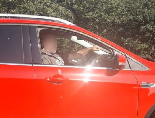"""PIC FROM Kennedy News and Media (PICTURED: ANGRY DRIVER CONFRONTS GEORGE DUNKERLEY FOR APPEARING TO USE PHONE WHILE DRIVING) A driver brazenly shared the moment he jumped out of his car to threaten another motorist in a foul-mouthed road rage bust-up - because he confronted him over 'using his phone at the wheel'. George Dunkerley, 40, was stuck in bad traffic on the A19 near Newcastle-upon-Tyne two weeks ago when he became embroiled in a spat with another driver. Footage filmed by George appears to show the safety-conscious commuter warning him that his cameras had caught George using his phone at the wheel - which George claims isn't true. Enraged, George shouts back: """"Why don't you go boil your head in a pan of piss, you stupid, useless, specky c**t."""" SEE KENNEDY NEWS COPY - 0161 660 8596"""