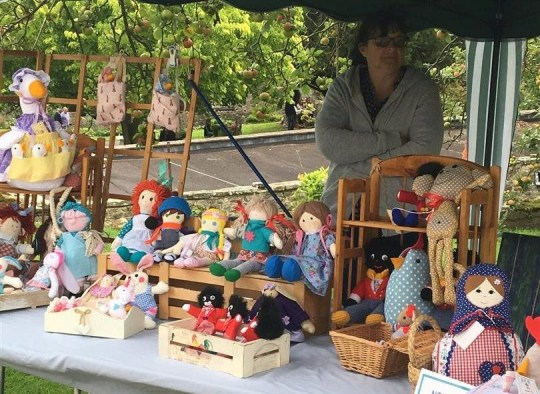 """Stallholder and dollmaker Christine Skeham stall , with golliwog dolls, on the grounds of Saltwood Castle, owned by late politician?s Alan Clark?s widow, Jane. Mrs. Clark has defended the stall, claiming the dolls are ?not racist at all?. Saltwood Castle, Hythe, Kent. September 17 2018 See national story NNGOLLI .A charity event held at the castle of Alan Clark's widow has been slammed for allowing """"racist"""" golliwogs to be sold. Mum Rebecca Wise said she was """"shocked"""" when saw the """"outdated"""" toys on one of the stalls. But Jane Clark, who owns Saltwood Castle where the open garden fundraiser was held, defended the stallholder saying the dolls were """"not racist"""" and """"beautifully made"""". Speaking inside the 12th-century castle grounds near Hythe in Kent Jane said: """"I bought one myself."""