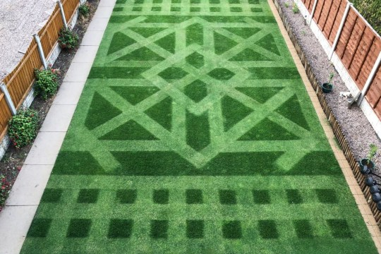 **MANDATORY BYLINE** Pic by Keith Smith/Caters News - (Pictured: Keith Smiths lawn at its finished state in August 2018) - A garden wizard has created a captivating front lawn using an antique mower from the 1940s. Keith Smith, 41, wowed judges at this years Creative Lawn Stripes Competition with his unique design. It is the third successive prize-winning design Mr Smith has dreamt up, having previously won awards with his Union Flag design. SEE CATERS COPY
