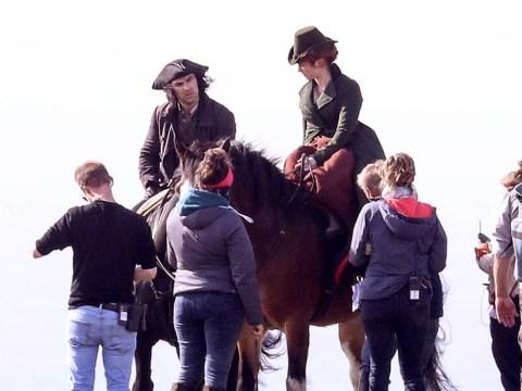 On the trot: Aidan Turner and Eleanor Tomlinson film Poldark action scenes on horseback