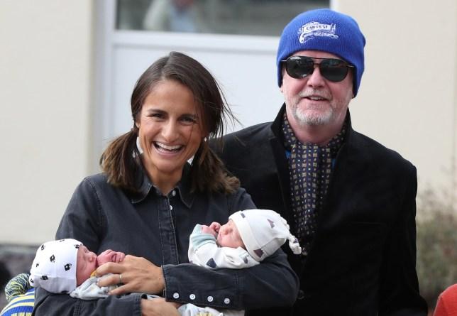 Chris Evans and Natasha Shishmanian pose with newborn ...
