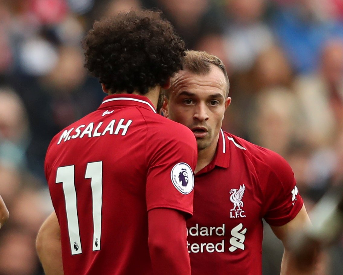 """Soccer Football - Premier League - Liverpool v Southampton - Anfield, Liverpool, Britain - September 22, 2018 Liverpool's Xherdan Shaqiri speaks with teammate Mohamed Salah before taking a free-kick Action Images via Reuters/Lee Smith EDITORIAL USE ONLY. No use with unauthorized audio, video, data, fixture lists, club/league logos or """"live"""" services. Online in-match use limited to 75 images, no video emulation. No use in betting, games or single club/league/player publications. Please contact your account representative for further details."""
