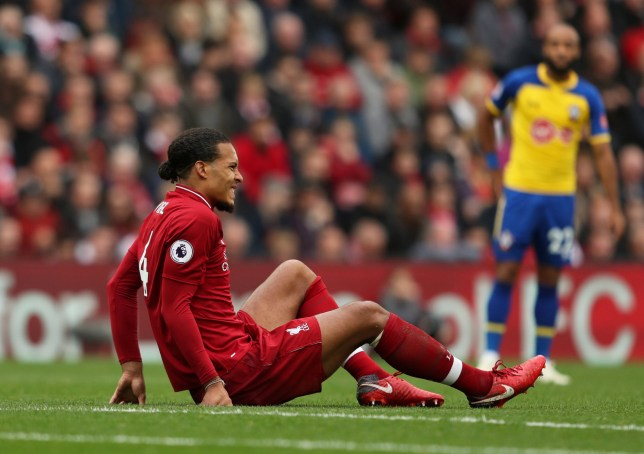"Soccer Football - Premier League - Liverpool v Southampton - Anfield, Liverpool, Britain - September 22, 2018 Liverpool's Virgil van Dijk goes down after sustaining an injury Action Images via Reuters/Lee Smith EDITORIAL USE ONLY. No use with unauthorized audio, video, data, fixture lists, club/league logos or ""live"" services. Online in-match use limited to 75 images, no video emulation. No use in betting, games or single club/league/player publications. Please contact your account representative for further details."