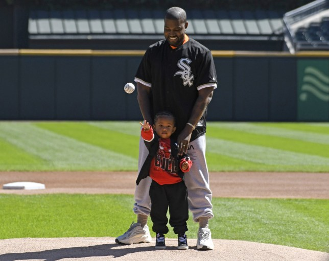 CHICAGO, IL - SEPTEMBER 23: Kanye West and his son Saint throw out a ceremonial first pitch before the game between the Chicago White Sox and the Chicago Cubs on September 23, 2018 at Guaranteed Rate Field in Chicago, Illinois. (Photo by David Banks/Getty Images)