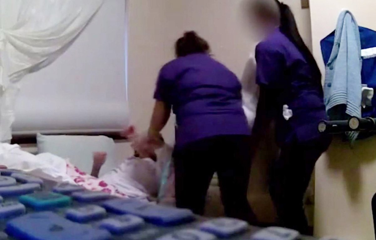 Nursing home workers push grandmother's head down at Morrison Lodge in Australia