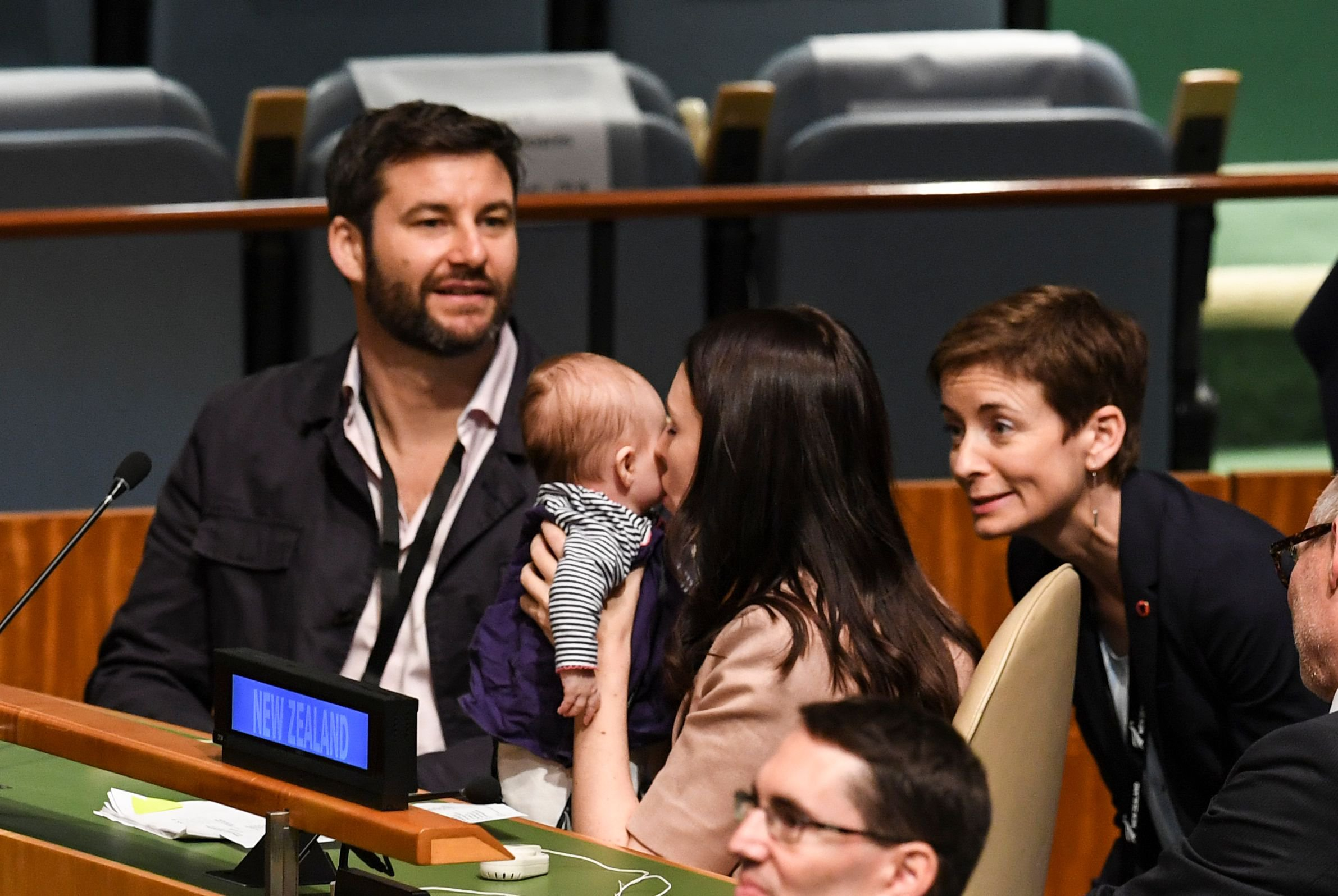 Jacinda Ardern, Prime Minister and Minister for Arts, Culture and Heritage, and National Security and Intelligence of New Zealand kisses her daughter Neve Te Aroha Ardern Gayford, as her husband Clarke Gayford (L) looks on during the Nelson Mandela Peace Summit September 24, 2018, one day before the start of the General Debate of the 73rd session of the General Assembly at the United Nations in New York. (Photo by Don EMMERT / AFP)DON EMMERT/AFP/Getty Images