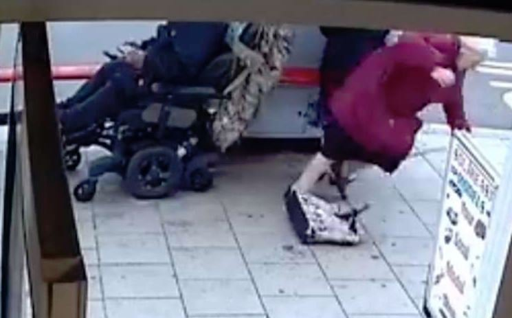 Pic shows CCTV still. A disabled man used his mobility scooter as a 'battering ram' to knock over two elderly women on the pavement, a court heard. Aaron Ali, 40, allegedly reversed over Doris Collins, 88, and Joan Benjafield, 90, while they were out shopping in Welling, Kent. The two pensioners were waiting at a bus stop outside South East Models shop on Upper Wickham Lane on June 14 this year when they were run over by Ali. Ali is also accused of ambushing 72-year-old Michael Gibson in another random attack in nearby Woolwich High Street on January 2. Ms Collins and Ms Benjafield were waiting to get on a number 96 bus when the ramp came down and Ali rode off on his scooter. CCTV footage played in court shows him pass the two women then suddenly stop. SEE STORY CENTRAL NEWS. 020 72360116. Picture: Metropolitan Police/ Central News