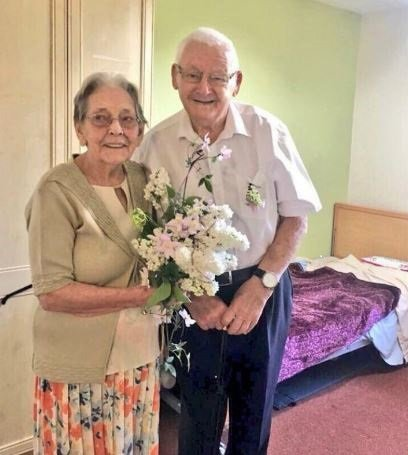A devoted couple who faced being separated after 70 years together have been told they will not be split up. Frank and Mary Springett's family feared they would be parted in a row over care home fees. Caption: Mary and Frank Springett