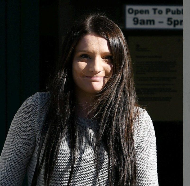 Elizabeth Wilkins pictured leaving court after being sentenced. See SWNS story SWSMILE; A Plymouth mum who was today convicted of attacking her baby son - leaving him with brain damage - has been pictured smiling as she walked out of court. Student Elizabeth Wilkins, aged 23, left her baby fighting for his life by shaking him and hitting his head against a hard surface. Wilkins appeared to be smiling as she was pictured leaving Plymouth Crown Court - less than two hours after the jury returned their guilty verdicts. Judge Peter Johnson, who adjourned sentencing for psychiatric and probation reports, granted Wilkins bail.