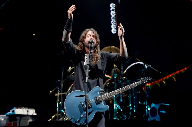 Dave Grohl Gifts 10 Year Old His Guitar As Pair Cover
