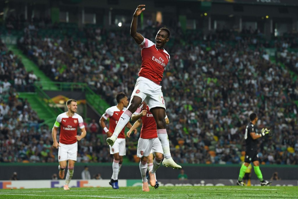 Arsenal make it 11 wins in a row thanks to Danny Welbeck's late winner against Sporting Lisbon