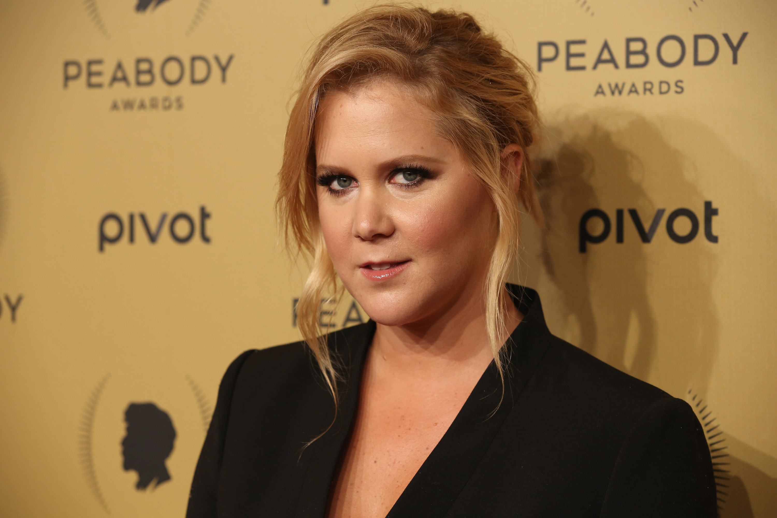 Pregnant Amy Schumer returns to work one day after being hospitalised with severe morning sickness
