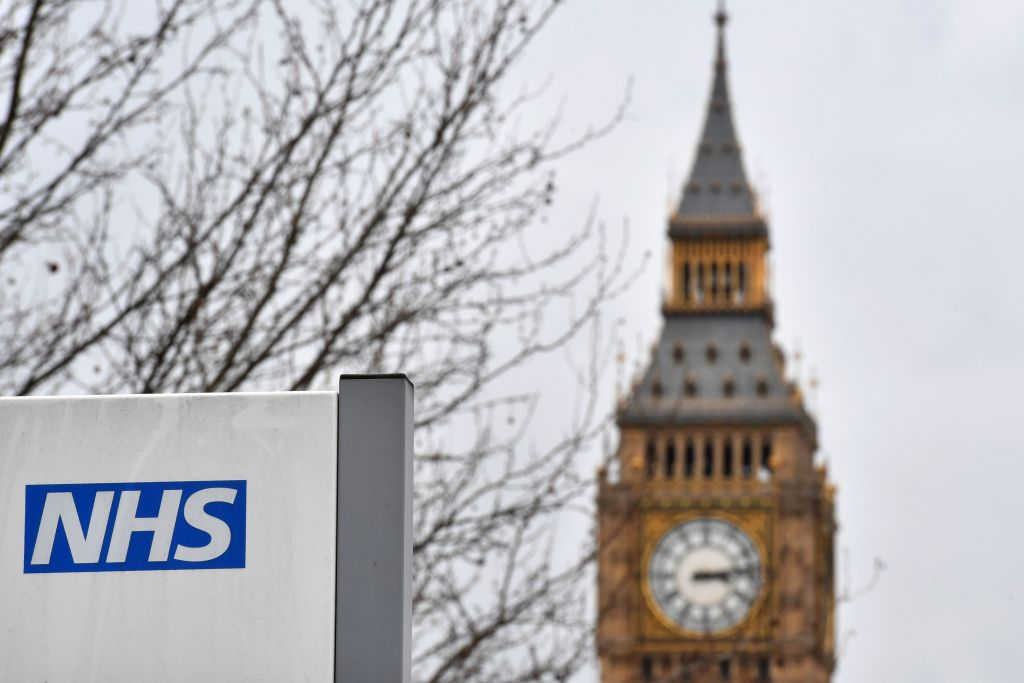 A NHS (National Health Service) sign is pictured outside St Thomas' Hospital, near the Houses of Parliament, in central London on March 8, 2017. Britain's economy will grow by 2.0 percent this year, sharply up on a previous forecast of 1.4 percent, finance minister Philip Hammond said Wednesday in his budget statement. Hammond also announced a two billion pound increase in spending for social care, over the next three years, in an effort to tackle pressure on the NHS. / AFP PHOTO / BEN STANSALL (Photo credit should read BEN STANSALL/AFP/Getty Images)