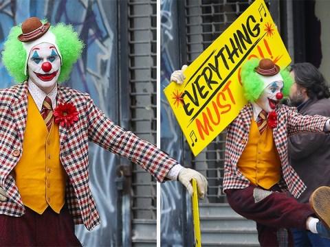 Joaquin Phoenix dances in a happy clown costume as Arthur Fleck begins his descent into the villainous Joker