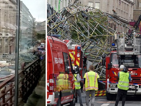 One dead after scaffolding several stories high collapses onto street