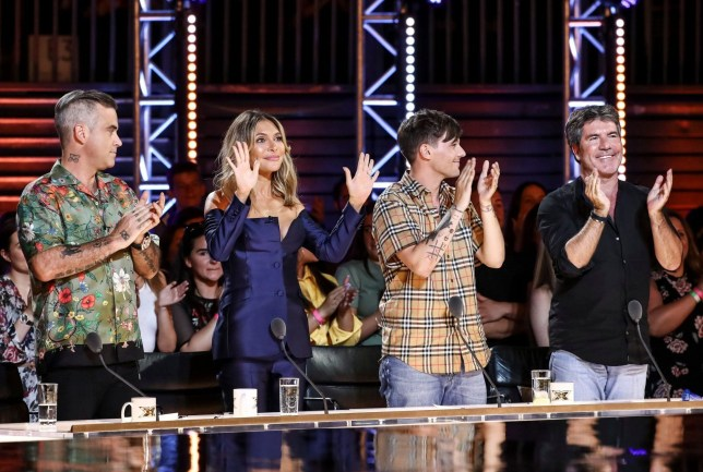 STRICT EMBARGO - NO USE BEFORE 21:00GMT SUNDAY 16TH SEPTEMBER 2018. EDITORIAL USE ONLY - NO MERCHANDISING. Mandatory Credit: Photo by Dymond/Thames/Syco/REX (9882774b) Robbie Williams, Ayda Williams, Louis Tomlinson and Simon Cowell during the performance of Shan 'The X Factor' TV show, Series 15, Episode 6, UK - 16 Sep 2018