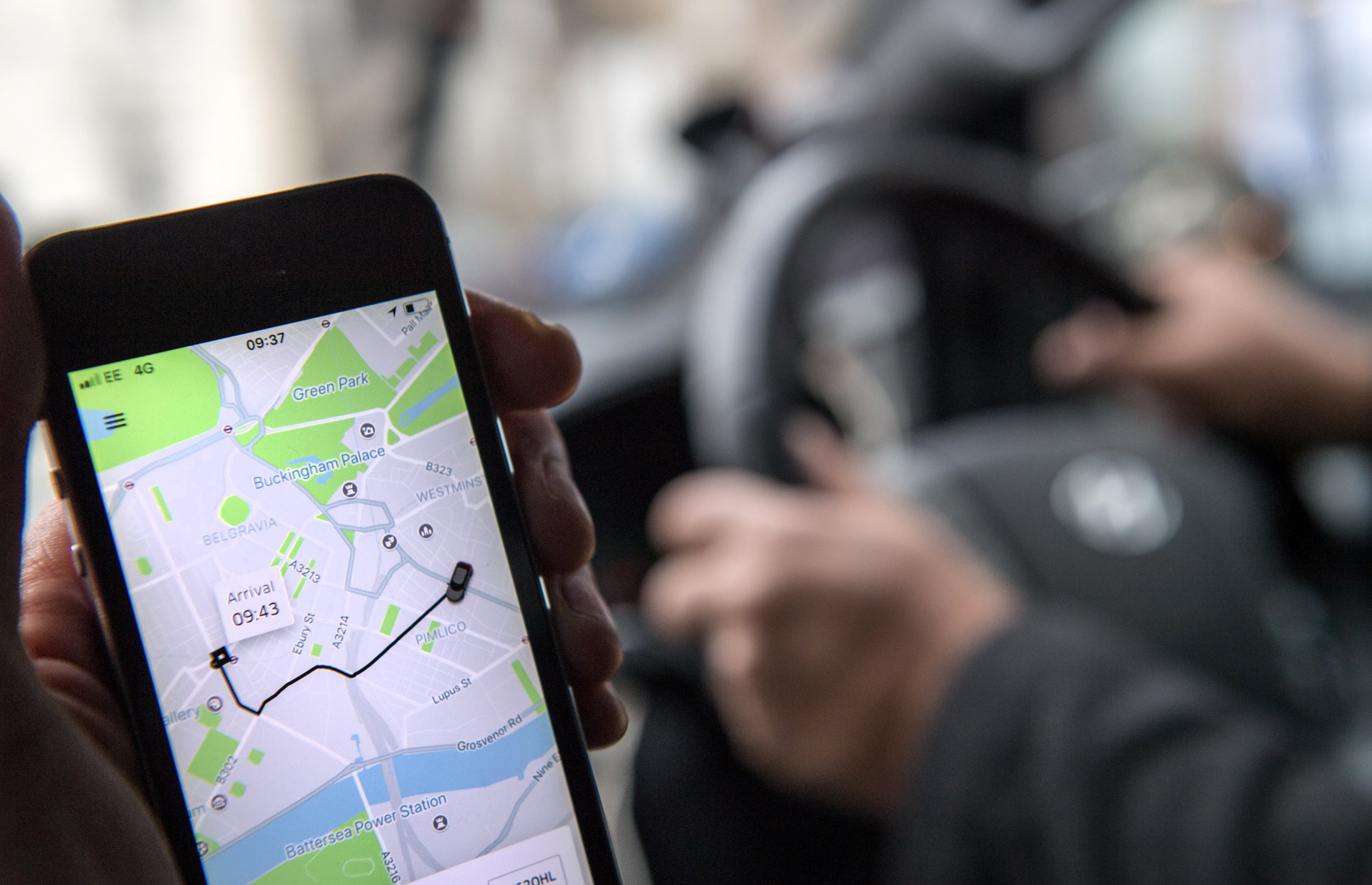 The Uber Technologies Inc. ride-hailing service smartphone app sits on a smartphone display during a journey in this arranged photograph in London, U.K., on Friday, Dec. 22, 2017. Uber will be regulated in European Union countries as a transport company after the bloc's top court rejected its claim to be a digital service provider, a decision that could increase legal risks for other gig-economy companies including Airbnb. Photographer: Chris J. Ratcliffe/Bloomberg via Getty Images