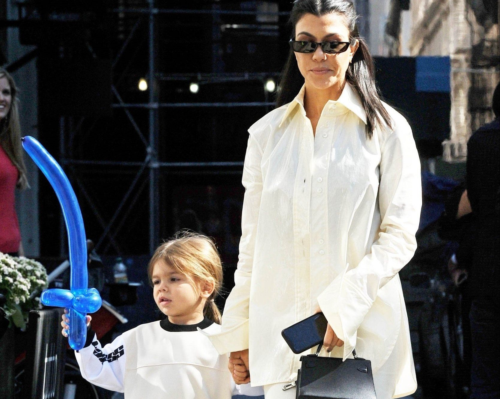 New York, NY - Kourtney Kardashian and her son Reign leave Tutto Il Giorno after a friend's birthday party. Kourtney wows in all white as she leaves the venue hand in hand with her youngest son. Pictured: Kourtney Kardashian BACKGRID USA 30 SEPTEMBER 2018 BYLINE MUST READ: JosiahW / BACKGRID USA: +1 310 798 9111 / usasales@backgrid.com UK: +44 208 344 2007 / uksales@backgrid.com *UK Clients - Pictures Containing Children Please Pixelate Face Prior To Publication*