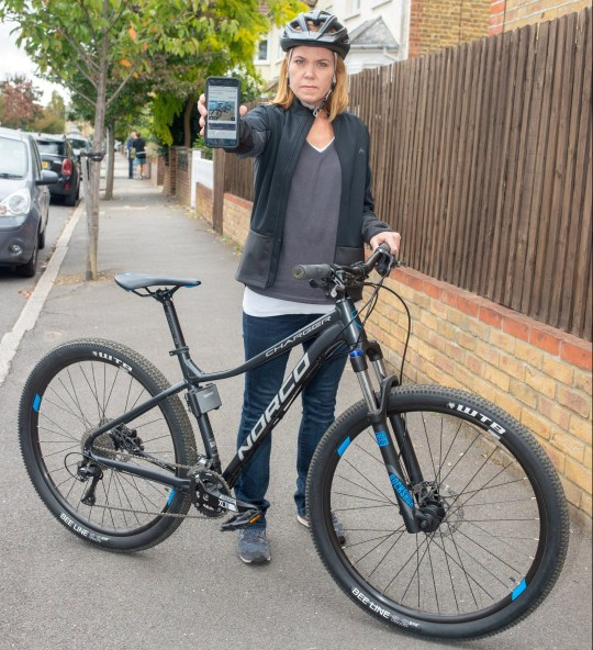 """Sharron Jenson, pictured with the advert for the bike that was stolen. See SWNS story SWSYbike. A mum was forced to 'steal back' her own bike from thieves after police closed the case due to 'lack of evidence' - despite her turning detective and tracking him down. Sharron Jenson's bike was stolen from her local high street and after it popped up on Gumtree days later she followed police advice to contacted him as a 'buyer'. But despite getting his first name, an address and phone number, police refused to accompany her to the thief's home, forcing her to go alone. She nabbed back the bike by posing as a buyer and then cycled off, and after confirming it was hers she informed police - giving them a detailed description of the alleged criminal. But officers said there was a """"insufficient information to proceed with an investigation"""". Housewife Sharron from south London has slammed the """"state of policing"""". She said: """"It has made me realise how bad the state of police is here. """"It's unbelievable that victims of crimes are having to investigate and then collect their own stolen items.???"""