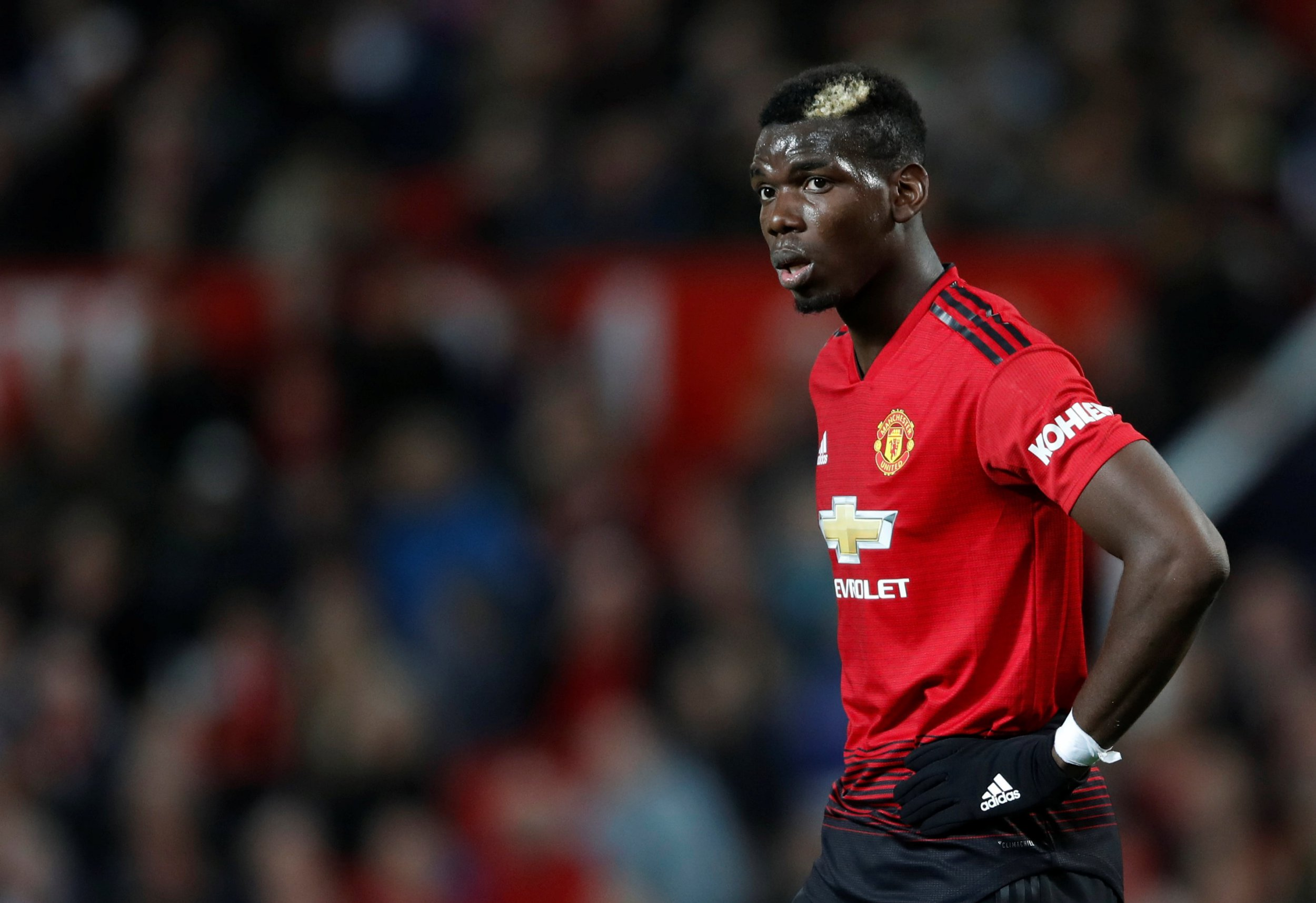 """Soccer Football - Premier League - Manchester United v Newcastle United - Old Trafford, Manchester, Britain - October 6, 2018 Manchester United's Paul Pogba during the match Action Images via Reuters/Carl Recine EDITORIAL USE ONLY. No use with unauthorized audio, video, data, fixture lists, club/league logos or """"live"""" services. Online in-match use limited to 75 images, no video emulation. No use in betting, games or single club/league/player publications. Please contact your account representative for further details."""