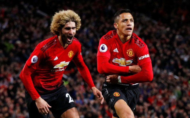 """Soccer Football - Premier League - Manchester United v Newcastle United - Old Trafford, Manchester, Britain - October 6, 2018 Manchester United's Alexis Sanchez celebrates scoring their third goal with Marouane Fellaini REUTERS/Phil Noble EDITORIAL USE ONLY. No use with unauthorized audio, video, data, fixture lists, club/league logos or """"live"""" services. Online in-match use limited to 75 images, no video emulation. No use in betting, games or single club/league/player publications. Please contact your account representative for further details."""