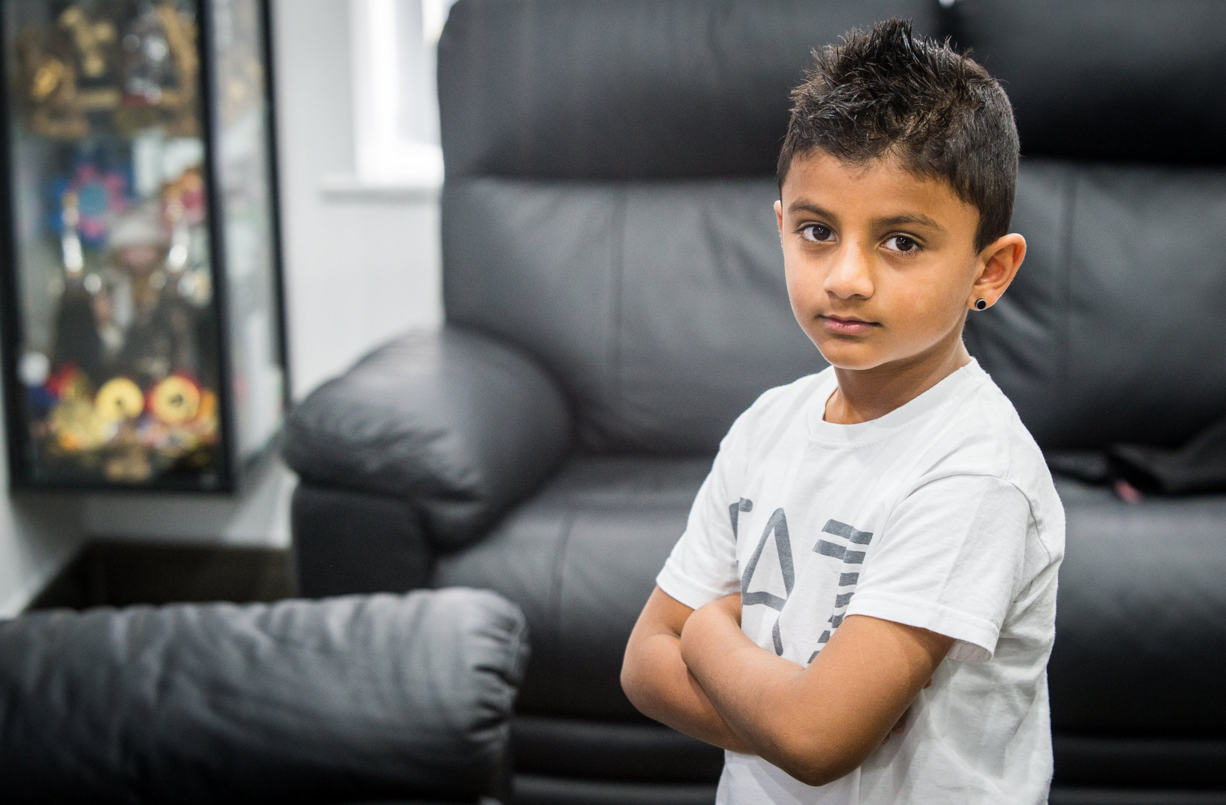 A concerned mother claims her seven-year-old son swallowed plastic pieces after biting into a vanilla-filled chocolate egg bought from Poundland. Kaelen Shah, seven, hurt his teeth when he bit into some of the ?hard rubbery? material, which he mistakenly thought to be cookie crumble. Caption: Kaelen Shah from Leicester, who allegedly swallowed some plastic while eating some 'Spoon it Out' vanilla filled milk chocolate eggs purchased from Poundland
