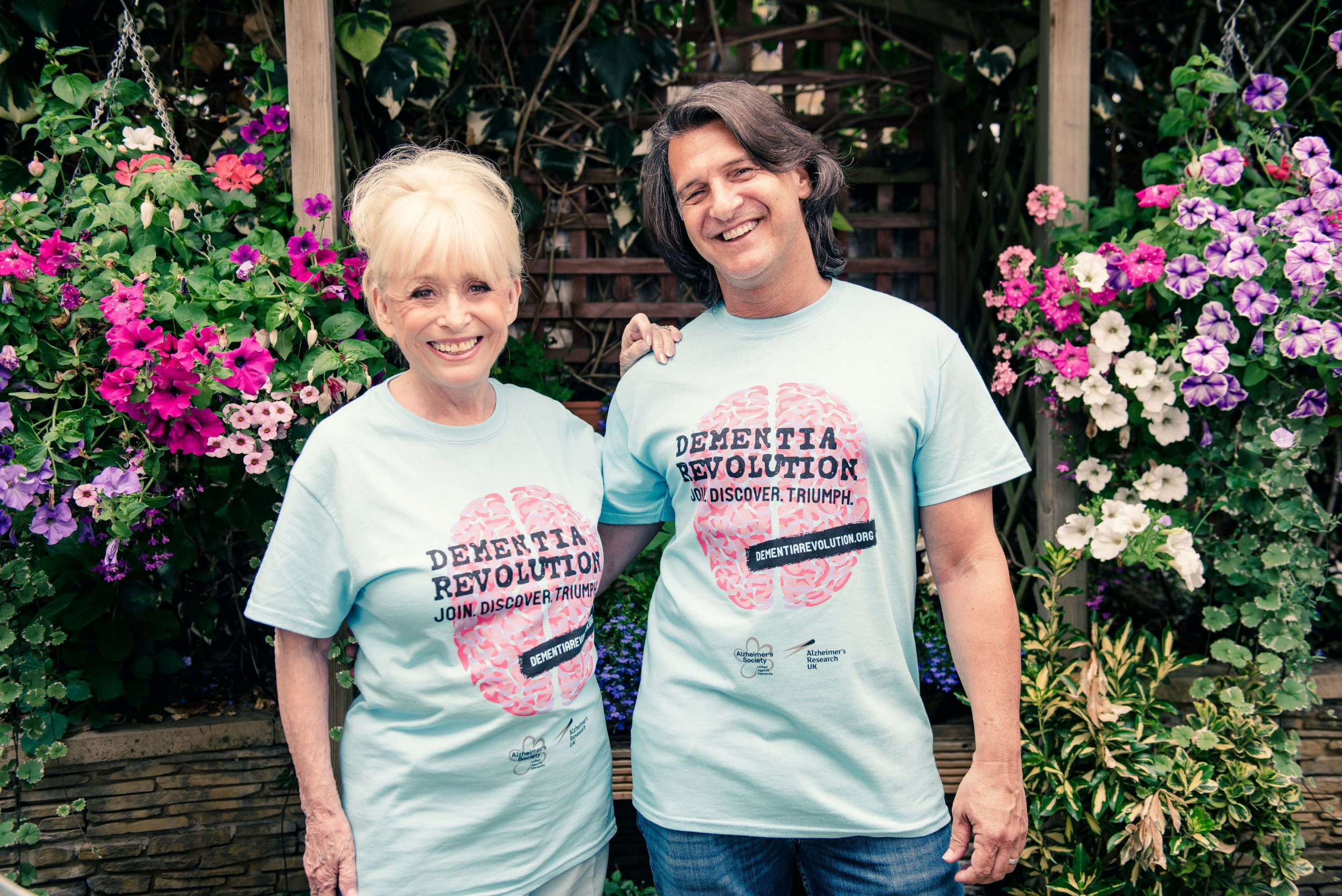 """Undated handout photo issued by the Alzheimer?s Society of Dame Barbara Windsor (left) and husband Scott Mitchell. Ms Windsor has appeared on video for the first time to speak publicly about dementia - as her husband said that """"there is still so much of her there"""" despite her illness. PRESS ASSOCIATION Photo. Issue date: Monday October 08, 2018. With her trademark twinkle in her eye, the ex-Carry On and EastEnders' star, 81, is filmed in her home. See PA story SHOWBIZ Dementia. Photo credit should read: Alzheimer?s Society/PA Wire NOTE TO EDITORS: This handout photo may only be used in for editorial reporting purposes for the contemporaneous illustration of events, things or the people in the image or facts mentioned in the caption. Reuse of the picture may require further permission from the copyright holder."""