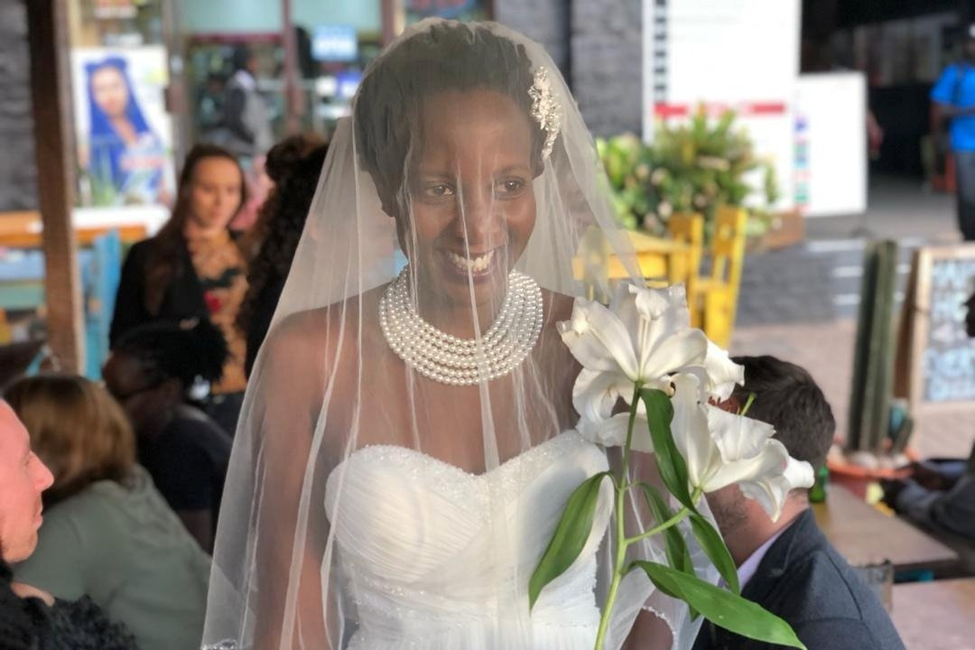 """Lulu Jemimah pictured on the day she got married - to herself. See SWNS story SWOCmarriage; A single student sick of being asked when she was tying the knot got married TO HERSELF - and the entire big day cost just ?2. Lulu Jemimah, 32, said her family lectured her on the importance of marriage and finding a man nearly every day. But independent Lulu is currently in the middle of a masters in creative writing at the University of Oxford, so marriage is the last thing on her mind. So to show her commitment to """"loving herself"""" and her studies - and to get her parents off her back - she arranged her own wedding."""