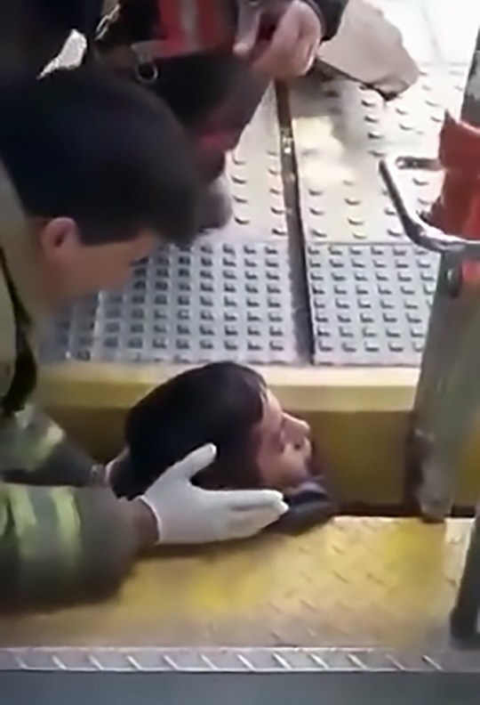 "Pic Shows: The boy with his head stuck in the platform gap being rescued; This the moment a young man with head stuck between a train and the platform is rescued by firefighters. The incident occurred on a train in the Merlo area of the Argentinian province of Buenos Aires. Local media report the young man, identified as Jose Alejandro Centurion, 20, had been running off the moving train during a fight but fell and got stuck between the gap between the train and the platform. In the video, Centurion can be seen with just his head poking above the platform and the floor of the train. His body is stuck below the platform and firemen are working to free his head and allow to him to escape. The firemen work to push the train carriage away from the platform and one of the fireman waits below the train and catches Centurion when he falls after being freed. The operation reportedly lasted around 10 minutes. German Freire, the officer in charge of the local fire department, told local media that there is no indication of how the young man managed to fall into the gap. Reports suggest had had been drinking alcohol before the fall. Centurion was reportedly transferred to hospital were it was confirmed that he had suffered minor injuries in the incident. There is no update on his condition. Netizen ???Facu??? commented: ""This is what happens when you are dumb, let's see if he gets off a moving train again."""
