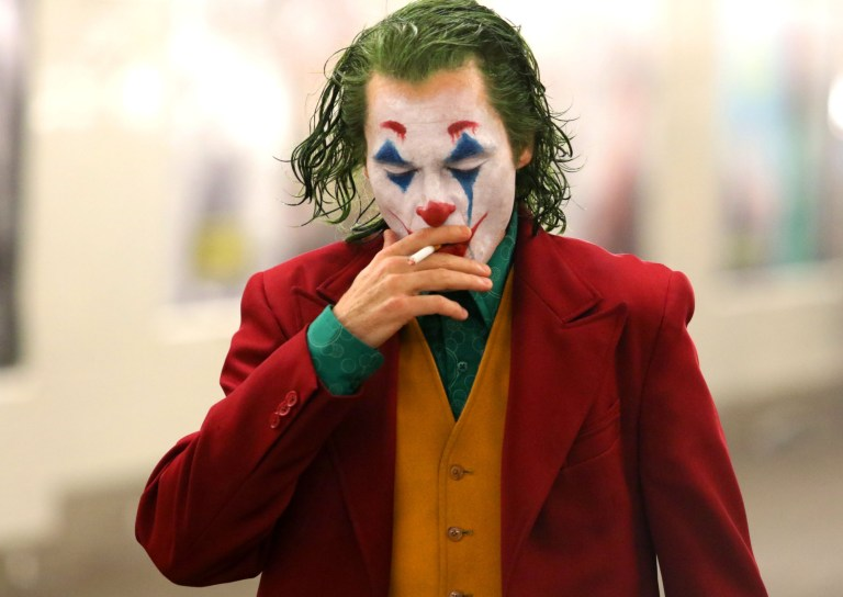 "Joaquin Phoenix is seen up close and personal and looking very menacing as the Clown Prince of Crime in full Joker make-up and costume as he shot dramatic scenes while smoking a cigarette and walking past several Gotham Police officers who were on hot pursuit for the scene. ""JOKER"" filming took place at an underground Subway train station in Brooklyn. Pictured: Joaquin Phoenix Ref: SPL5031570 081018 NON-EXCLUSIVE Picture by: SplashNews.com Splash News and Pictures Los Angeles: 310-821-2666 New York: 212-619-2666 London: 0207 644 7656 Milan: +39 02 4399 8577 Sydney: +61 02 9240 7700 photodesk@splashnews.com World Rights,"