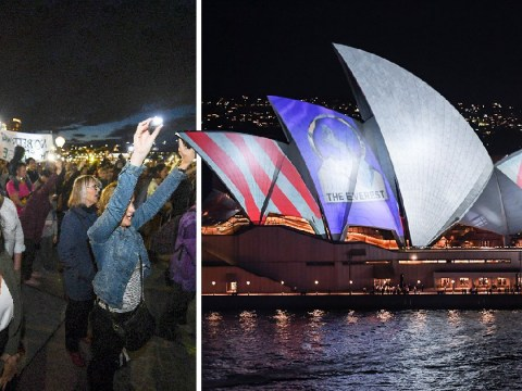 Protesters armed with torches block out Sydney Opera House advert
