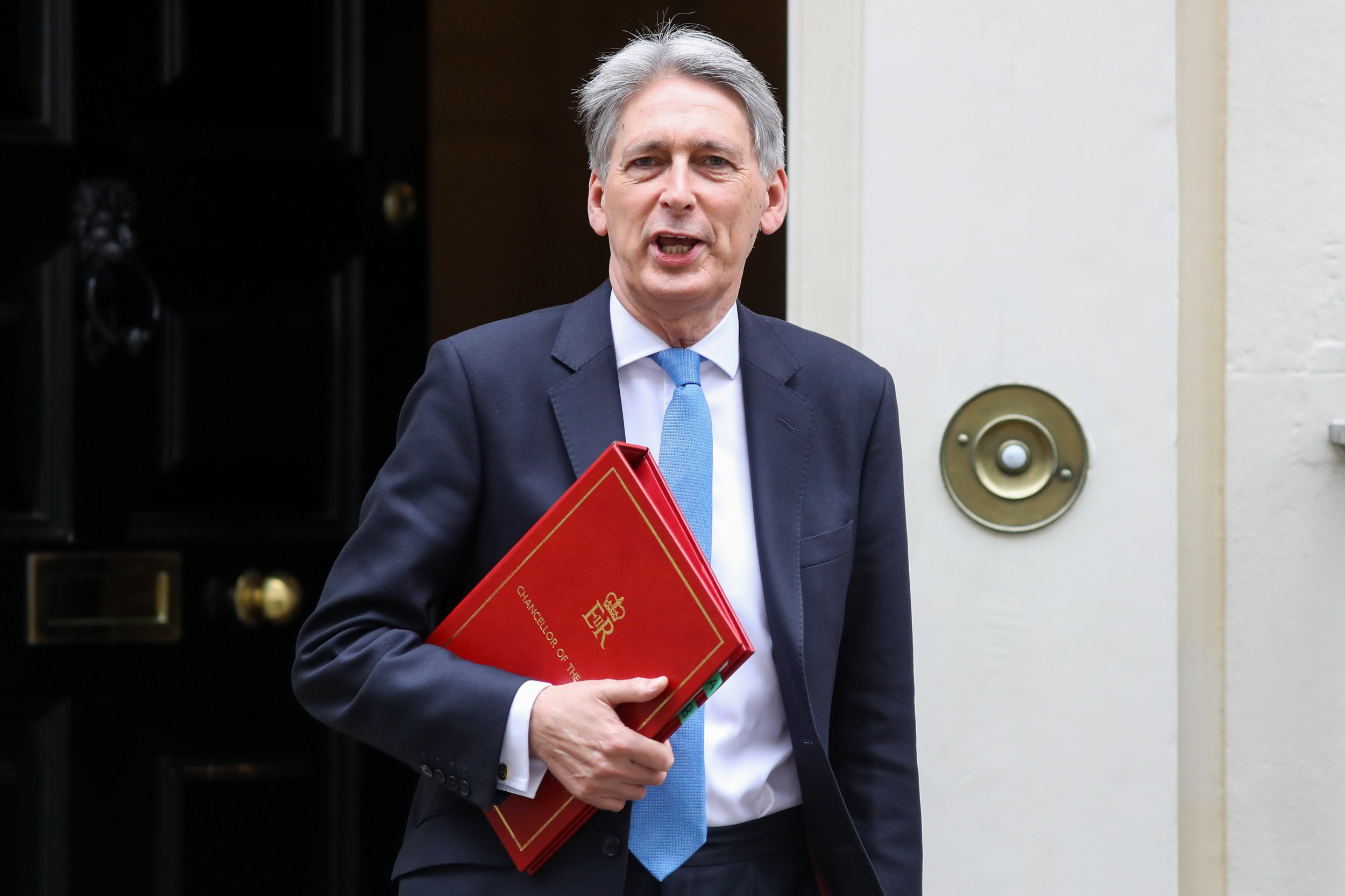 Philip Hammond, U.K. chancellor of the exchequer, leaves number 11 Downing Street to present the Spring Statement in Parliament in London, U.K., on Tuesday, March 13, 2018. This year 'Hammond'?has decided to do things differently, moving the main Budget announcement to the Autumn and reducing the Spring Statement one to a handful of forecasts on the shape of the economy that will last less than half an hour. Photographer: Simon Dawson/Bloomberg via Getty Images