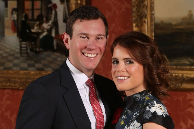 "(FILES) In this file photo taken on January 22, 2018 Britain's Princess Eugenie of York (R) poses with her fiance Jack Brooksbank in the Picture Gallery at Buckingham Palace in London on January 22, 2018, after the announcement of their engagement. - Five months on from Prince Harry and Meghan's fairytale nuptials, the time has come for ""the other"" royal wedding -- the one no one seems to want to pay for or watch. When Queen Elizabeth II's granddaughter Princess Eugenie walks down the aisle on October 12, 2018 in Windsor Castle to marry Jack Brooksbank, a ""commoner"" with blue-blood friends, the critics will be out. (Photo by Jonathan Brady / POOL / AFP)JONATHAN BRADY/AFP/Getty Images"