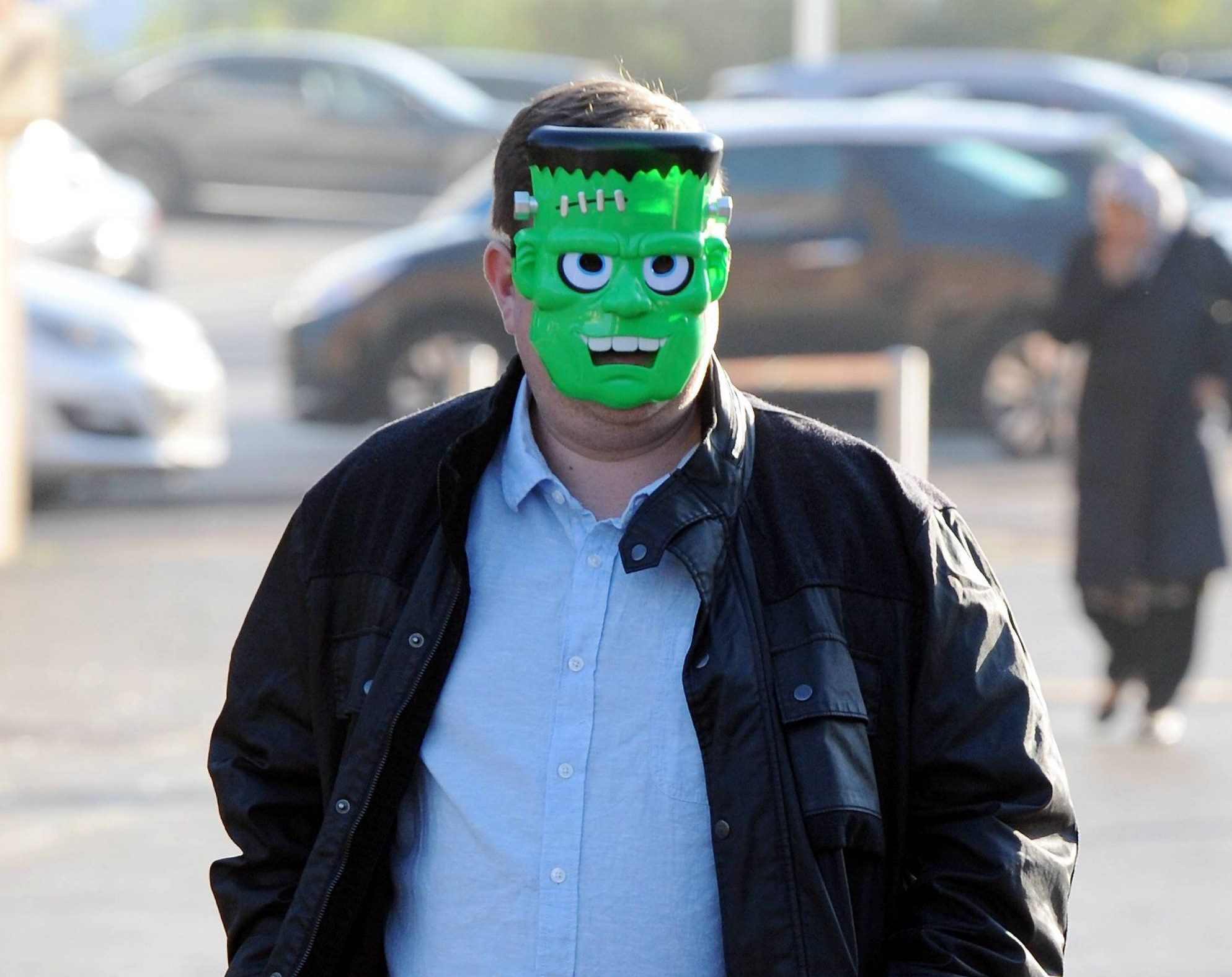 Dated: 10/10/2018 HOMELESS MAN PAINT ATTACK DEATH COURT CASE Painter and decorator Aaron Jones pictured arriving at Teesside Magistrates court today (Wed) wearing a Frankenstein mask. He is facing charges after posting the video of homeless man Michael Cash being covered in red paint outside of a TESCO store in Normanby, just days before Michael was found dead. See copy by North News