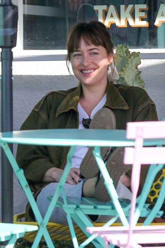 "West Hollywood, CA - *EXCLUSIVE* - Brunette star Dakota Johnson joined a friend this afternoon during a coffee break in the West Hollywood area. Dakota Johnson and boyfriends Chris Martin sparked pregnancy rumors as an array of celebrities arrived at the singer's Malibu house for what appeared to be a lavish 'baby gender reveal party' on Sunday. Screen stars Julia Roberts and Sean Penn were among the A-list guests pictured arriving at Chris' Malibu home, as well as Dakota???s parents Don Johnson and Melanie Griffith. According to published reports, reps for the ""Fifty Shades of Grey'' star issued a statement that the actress is not expecting and was simply hosting a birthday party, after turning 29 on October 4. Pictured: Dakota Johnson BACKGRID USA 10 OCTOBER 2018 USA: +1 310 798 9111 / usasales@backgrid.com UK: +44 208 344 2007 / uksales@backgrid.com *UK Clients - Pictures Containing Children Please Pixelate Face Prior To Publication*"