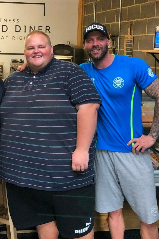 """Darren McClintock, 27 (L) with trainer, Mike Hind (R). Takeaways have been warned not to serve a morbidly obese man after doctors told him """"you're eating yourself to death"""". See SWNS story SWLEFAT. Darren McClintock, 27, was eating pasties, chips and pies daily before being given the urgent wake up call when he was hospitalised with heart problems. Darren, known as 'Dibsy', has now embarked on a healthy new lifestyle with the help of award-winning personal trainer Mike Hind. The two of them have have gone around their hometown of Middlesbrough handing out posters to all Dibsy's favourite restaurants saying """"do not serve this man"""". At the moment Dibsy has to book two seats on planes and order specially sized clothing that costs extra. He was served the wake up call after being admitted to hospital because his heart was beating too fast, when he says he could have died."""