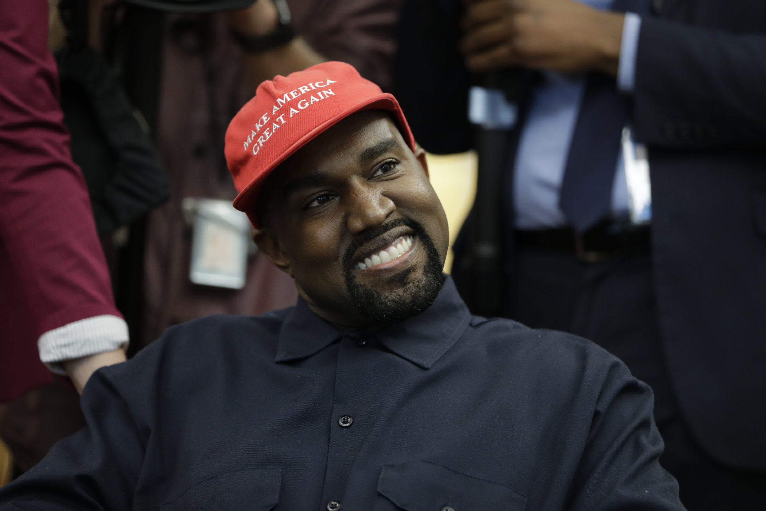 Rapper Kanye West is seated while meeting with President Donald Trump and others in the Oval Office of the White House, Thursday, Oct. 11, 2018, in Washington. (AP Photo/Evan Vucci)