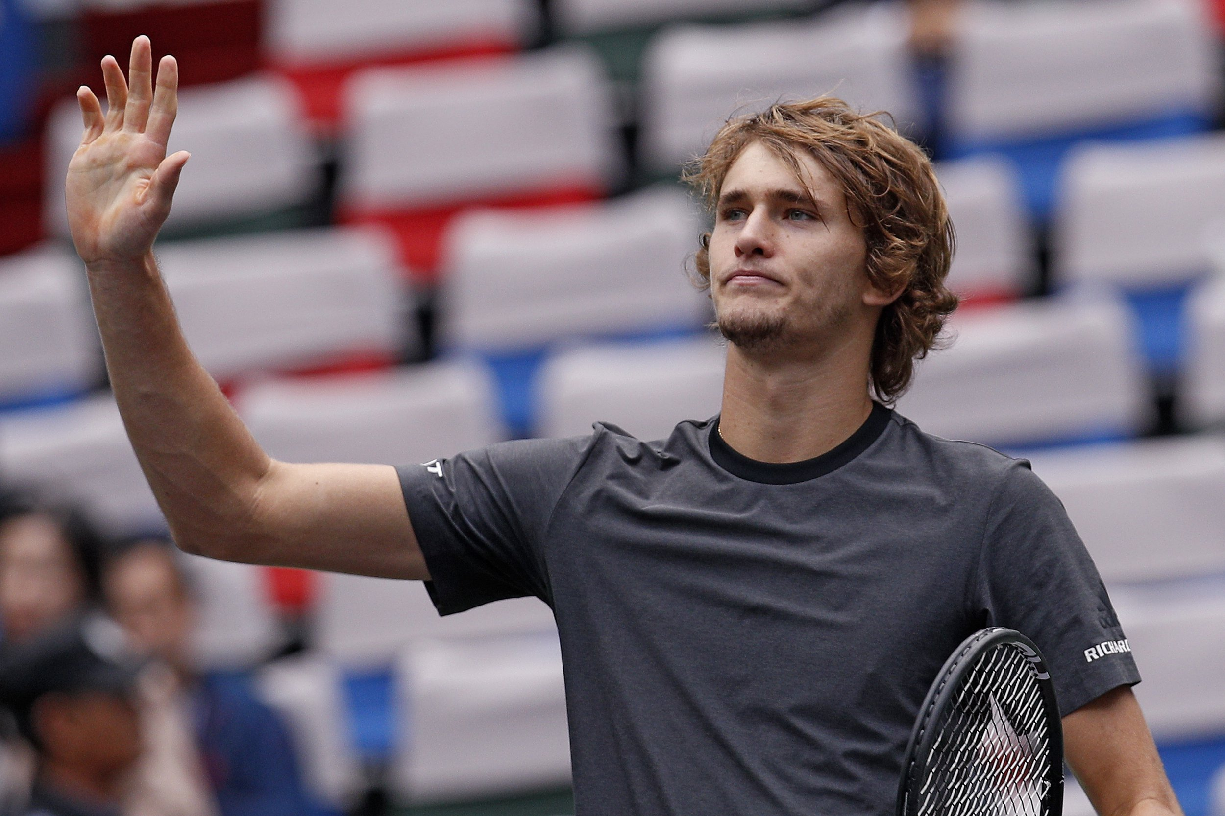 Alexander Zverev of Germany gestures to the spectators after winning his men's singles quarterfinals match against Kyle Edmund of Britain in the Shanghai Masters tennis tournament at Qizhong Forest Sports City Tennis Center in Shanghai, China, Friday, Oct. 12, 2018. (AP Photo/Andy Wong)
