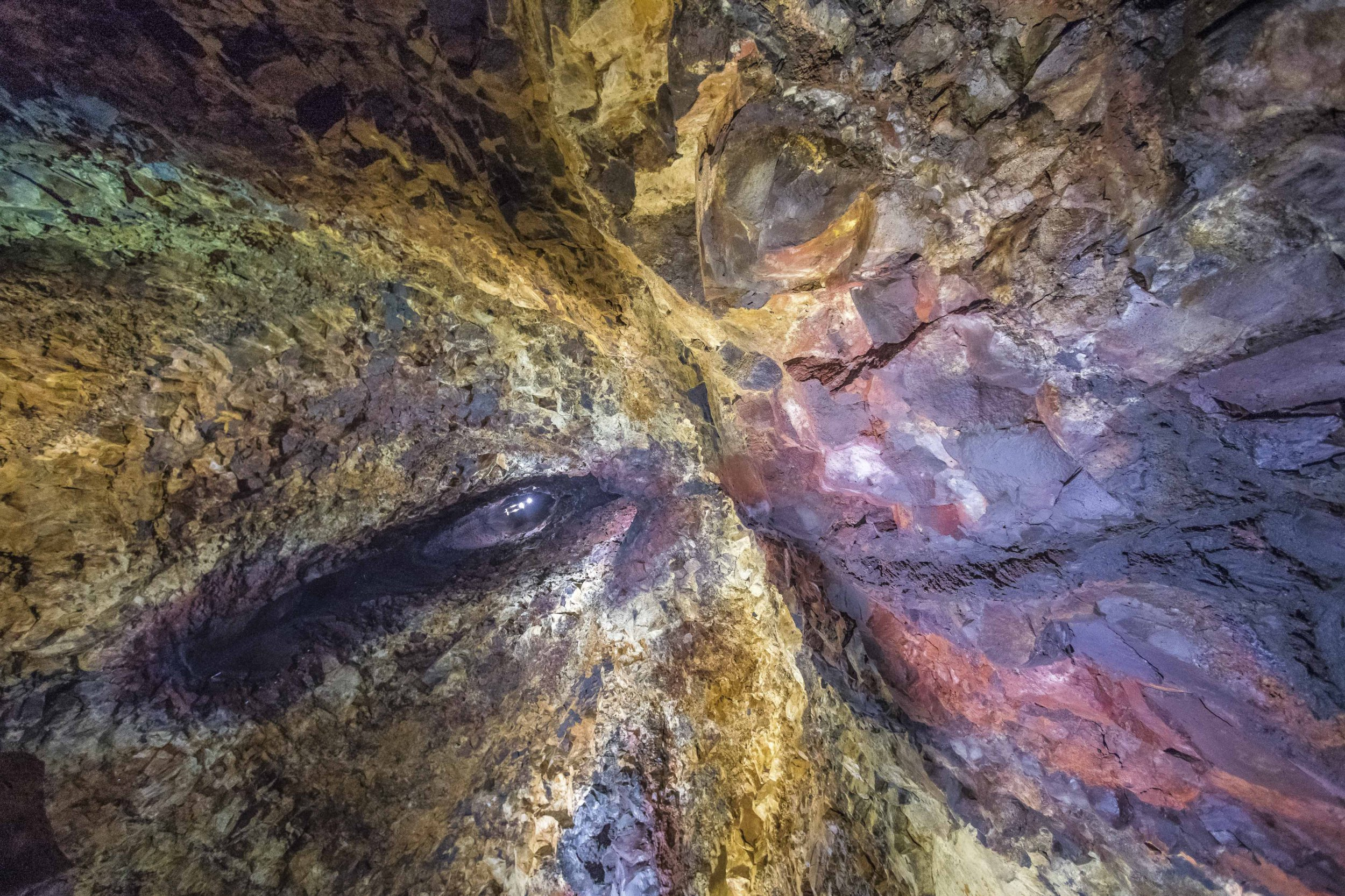 PIC FROM Florian Ledoux/Caters News - (PICTURED: Images showing the colourful cave walls in Iceland.) - Due to the last eruption, beautiful colours have been spread across these cave walls and the result is magical. Florian Ledoux, 29, a wildlife Arctic photographer, from Reykjavik, Iceland captured the images in Iceland. SEE CATERS COPY