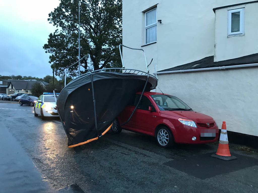A massive trampoline has been blown onto a car in Henwalia, Caernarfon WEATHER - Storm Callum. Friday October 12th. Henwalia, Caernarfon