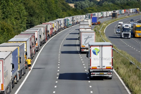 KENT, UNITED KINGDOM - JULY 31: Thousands of lorries backed up for miles on their way to Channel Tunnel on M20 in Kent, England as part of Operation Stack on July 31, 2015. Operation Stack forces freight vehicles to park on the motorway and wait to be loaded on to ships and trains to France because of the refugee chaos in Calais, France. These delays also affect many residents, businesses and holidaymakers. (Photo by Tolga Akmen/Anadolu Agency/Getty Images)
